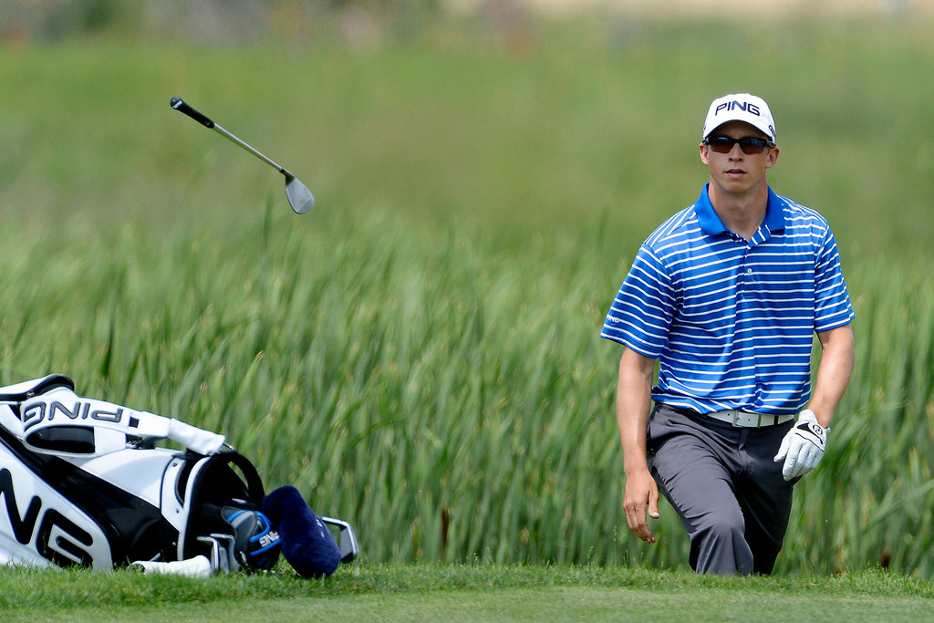 . Brandon Hagy tosses his club after hitting out of the rough during the Colorado Open.  (Photo by AAron Ontiveroz/The Denver Post)