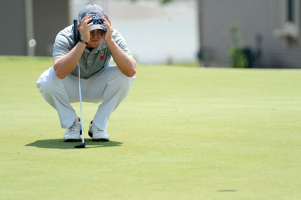 . Champion Ian Davis lines up a putt on the back nine during the Colorado Open.   (Photo by AAron Ontiveroz/The Denver Post)