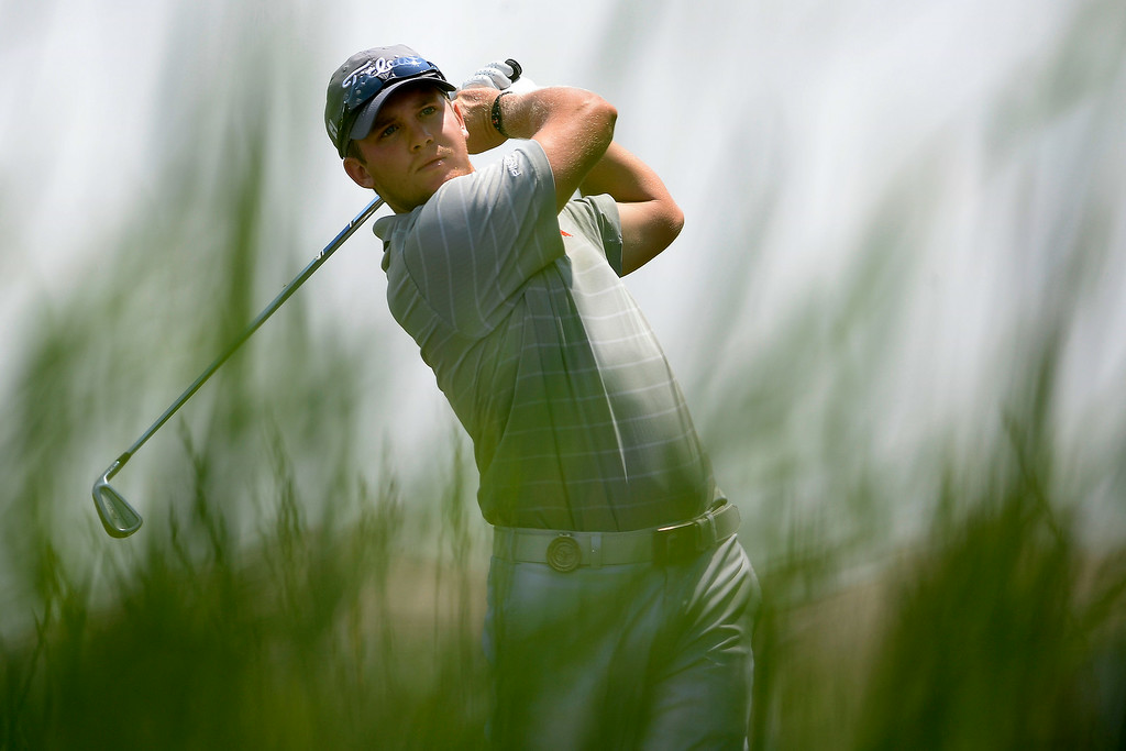 . Ian Davis hits a tee shot on the back nine during the Colorado Open on Sunday, July 27, 2014 at the Green Valley Ranch Golf Club. (Photo by AAron Ontiveroz/The Denver Post)