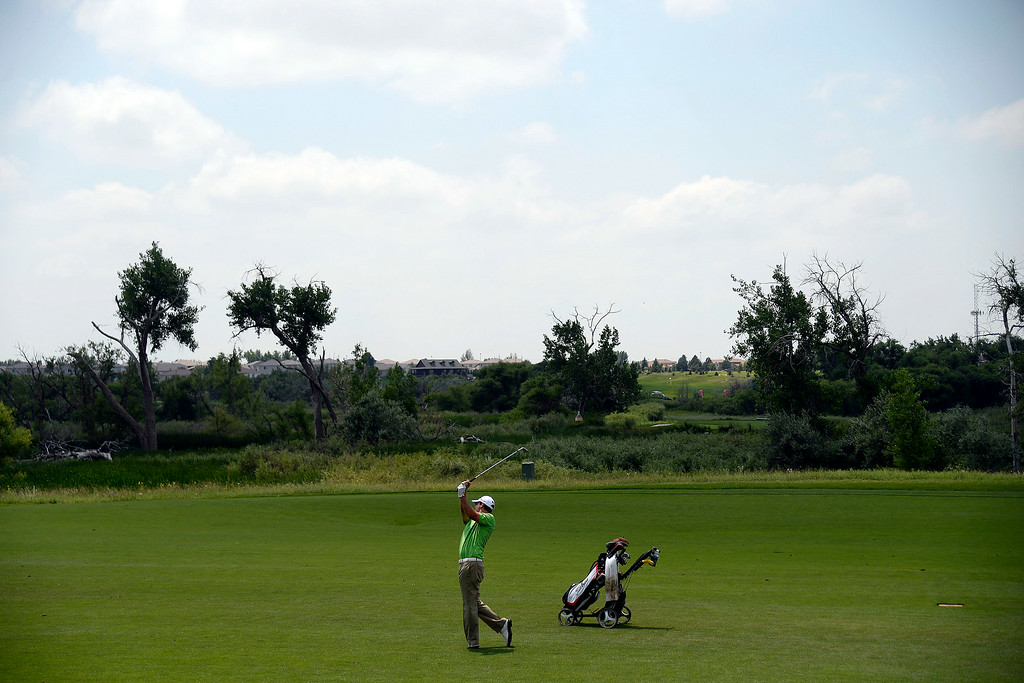 . Chris Ward hits his approach on the back nine during the Colorado Open.  (Photo by AAron Ontiveroz/The Denver Post)
