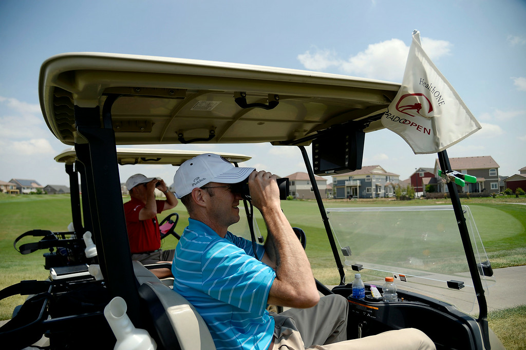 . Executive director of the Colorado Golf Association Ed Mate watches the lead group as they play the back nine during the Colorado Open.   (Photo by AAron Ontiveroz/The Denver Post)