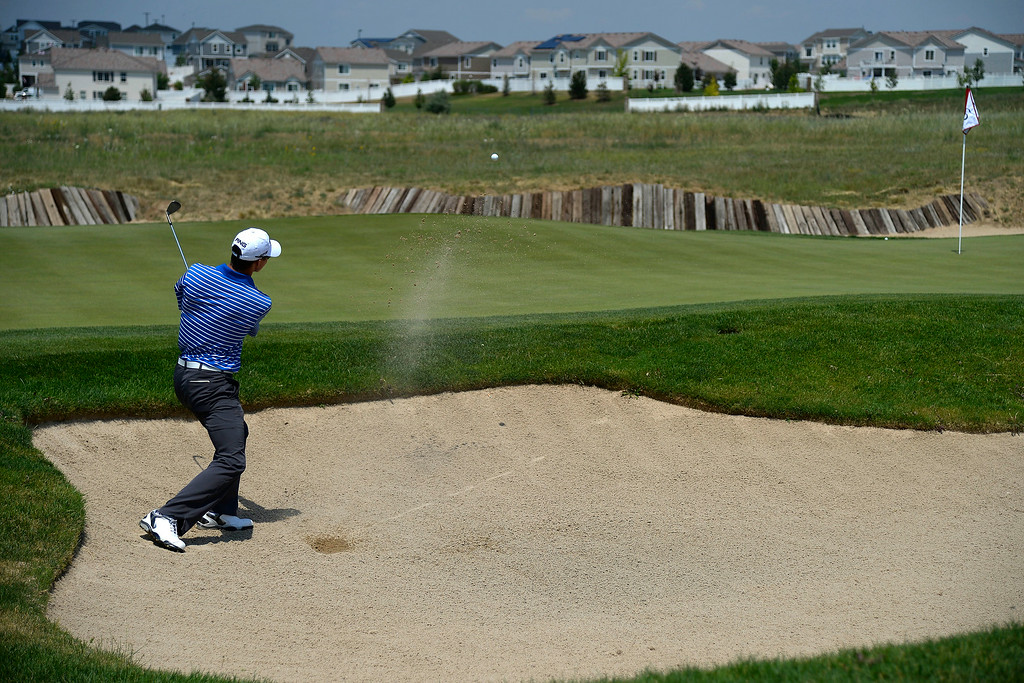 . Brandon Hagy hits out of a bunker on the back nine during the Colorado Open at the Green Valley Ranch Golf Club on Sunday, July 27, 2014. (Photo by AAron Ontiveroz/The Denver Post)