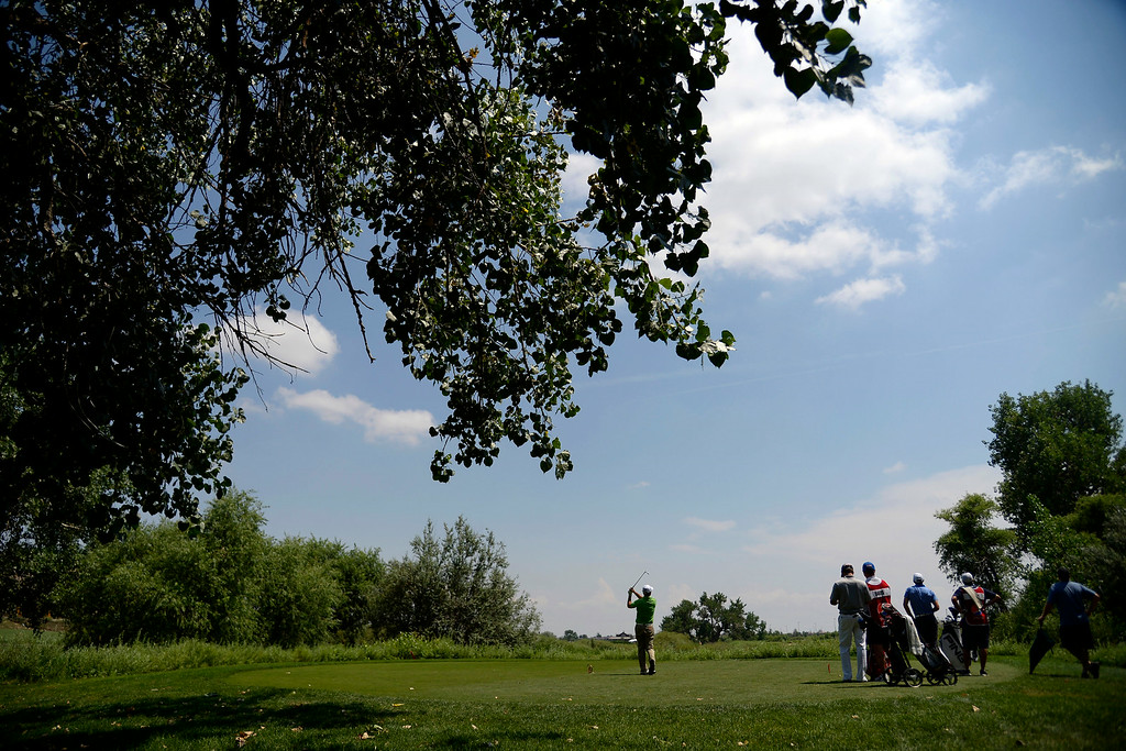 . Chris Ward tees off on 16 during the Colorado Open on Sunday, July 27, 2014. (Photo by AAron Ontiveroz/The Denver Post)