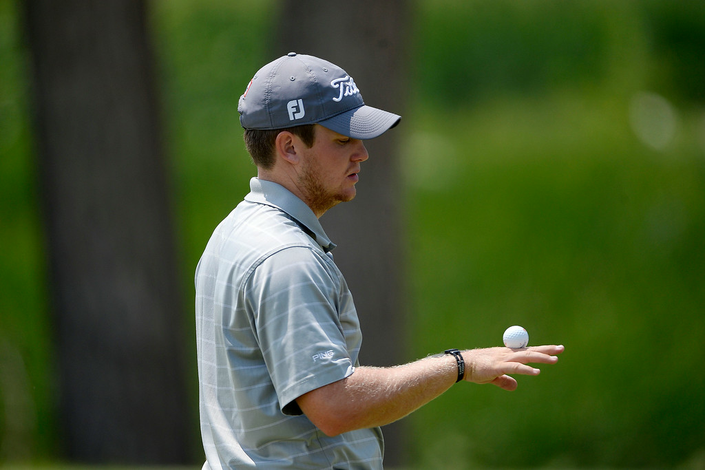 . Champion Ian Davis balances a ball on his hand as he waits to put on the back nine during the Colorado Open.   (Photo by AAron Ontiveroz/The Denver Post)