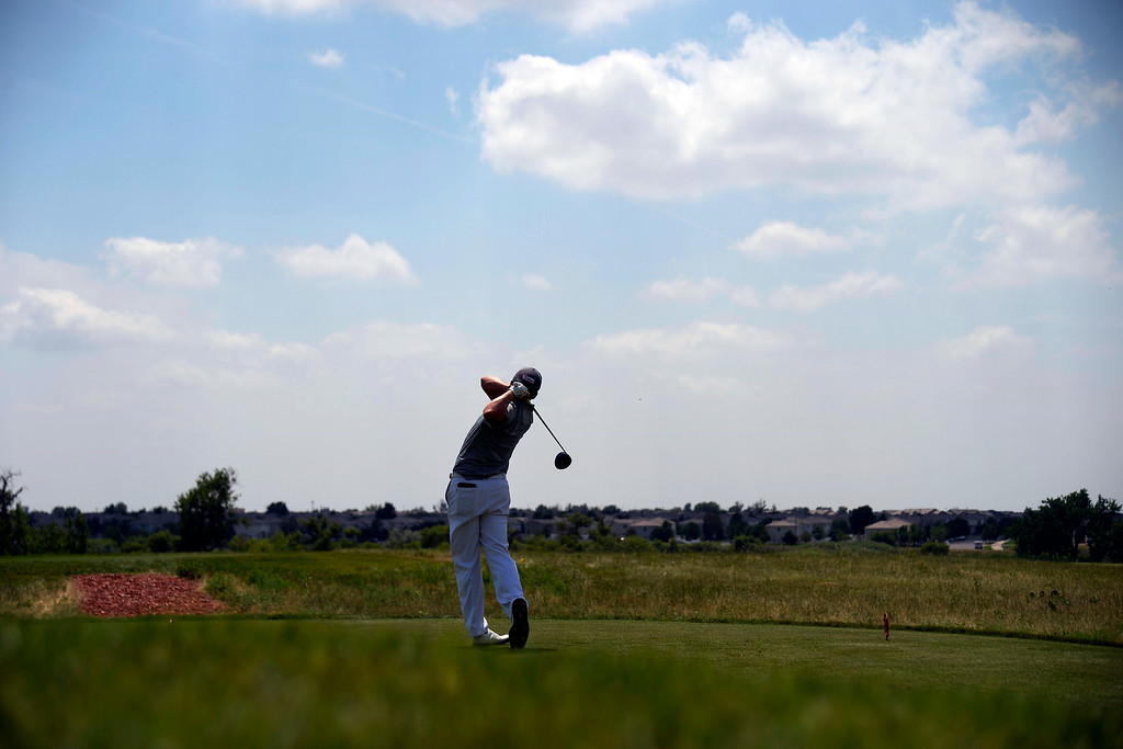 . Champion Ian Davis tees off on the back nine during the Colorado Open.  (Photo by AAron Ontiveroz/The Denver Post)