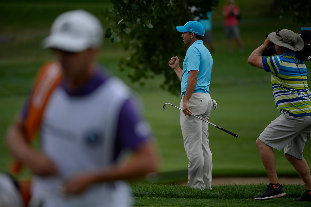. Sergio Garcia calmly celebrates a shot for an eagle on the 7th hole during the final round of the FedExCup BMW Championship at the Cherry Hills Country Club Sunday, September 07, 2014. (Photo By Andy Cross/The Denver Post)