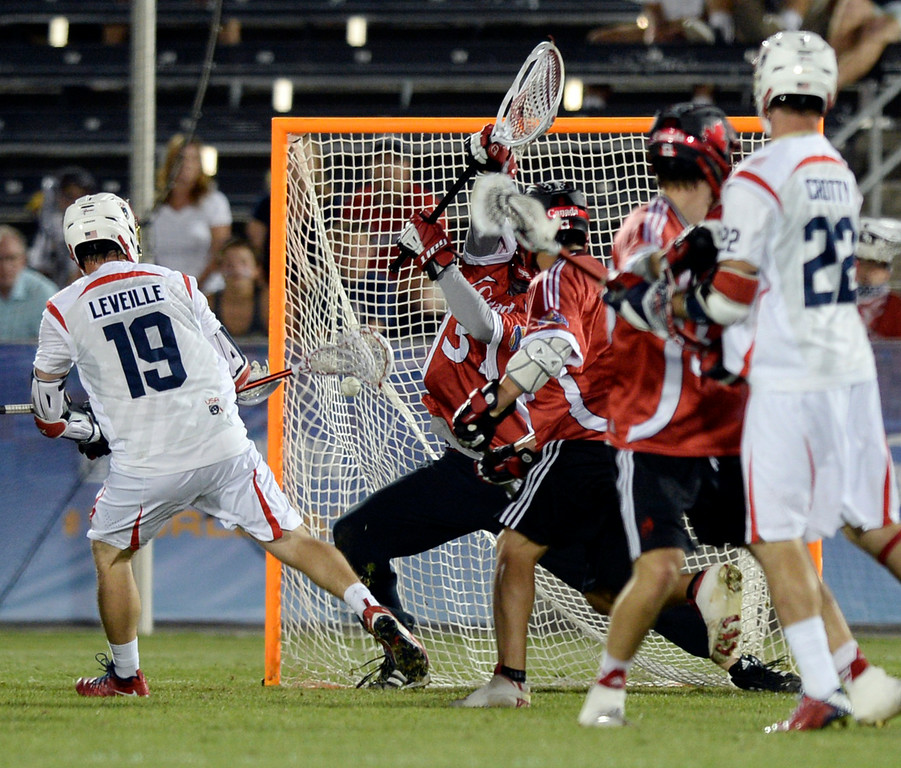 . COMMERCE CITY, CO - JULY 19:  US attack Kevin Leveille (19) put a shot past Canada goaltender Dillon Ward (37) in the second half. Canada defeated the United States 8-5 in the FIL World Lacrosse Championship game Saturday night, July 19, 2014.  Photo by Karl Gehring/The Denver Post
