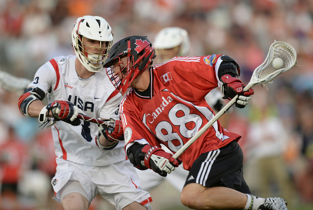 . COMMERCE CITY, CO - JULY 19: Canada attack Zack Greer (88) made a run against US midfielder Mathew Abbott (3) in the first half. The United States faced Canada in the FIL World Lacrosse Championship game Saturday night, July 19, 2014.  Photo by Karl Gehring/The Denver Post