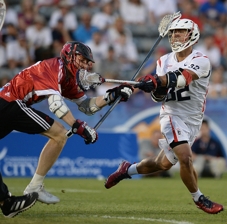 . COMMERCE CITY, CO - JULY 19:  US attack Rob Parnell (32) took a shot in the second half. Canada defeated the United States 8-5 in the FIL World Lacrosse Championship game Saturday night, July 19, 2014.  Photo by Karl Gehring/The Denver Post