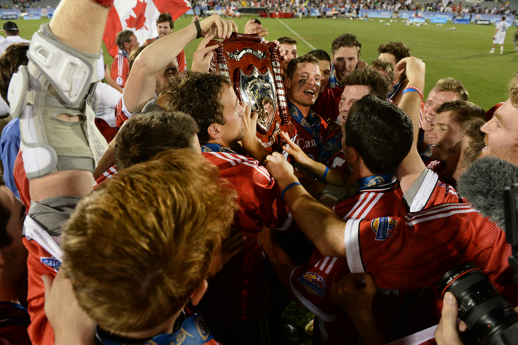. COMMERCE CITY, CO - JULY 19:  Canadian players celebrated with the championship trophy Saturday night. Canada defeated the United States 8-5 in the FIL World Lacrosse Championship game Saturday night, July 19, 2014.  Photo by Karl Gehring/The Denver Post