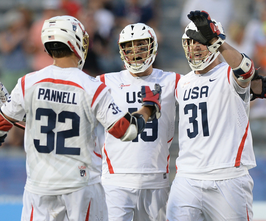 . COMMERCE CITY, CO - JULY 19:  The Americans celebrated a goal in the second half. Canada defeated the United States 8-5 in the FIL World Lacrosse Championship game Saturday night, July 19, 2014.  Photo by Karl Gehring/The Denver Post