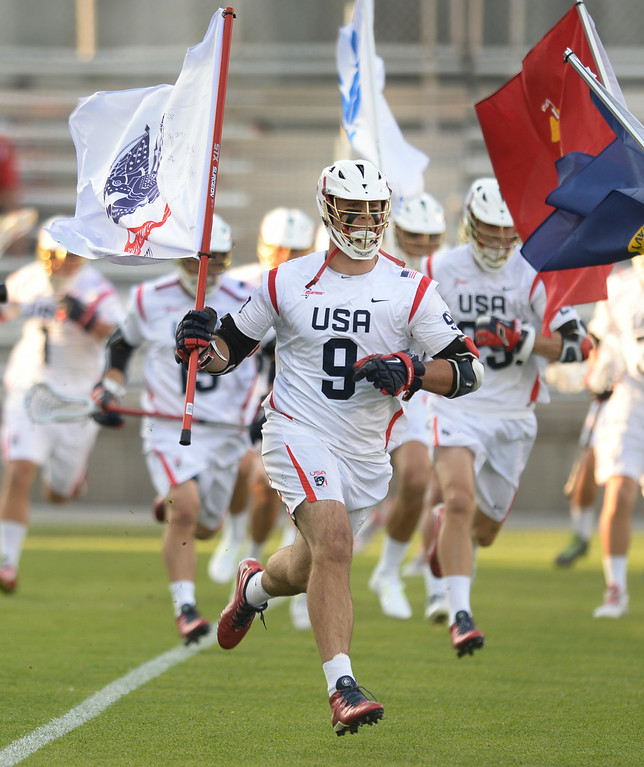 . COMMERCE CITY, CO - JULY 19: US attack Garrett Thul ran onto the field for the championship game Saturday. The United States faced Canada in the FIL World Lacrosse Championship game Saturday night, July 19, 2014.  Photo by Karl Gehring/The Denver Post