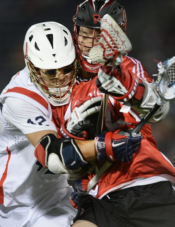 . COMMERCE CITY, CO - JULY 19:  Canada midfielder Jordan Hall (44) collided with US midfielder Max Seibald (42) in the second half. Canada defeated the United States 8-5 in the FIL World Lacrosse Championship game Saturday night, July 19, 2014.  Photo by Karl Gehring/The Denver Post