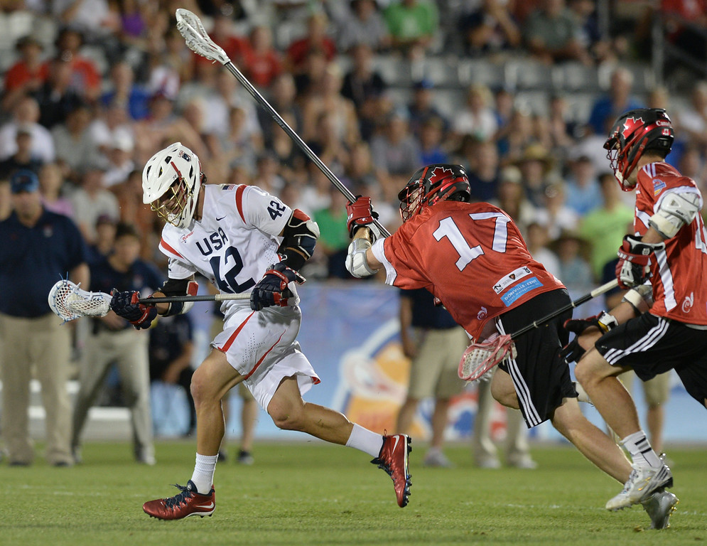 . COMMERCE CITY, CO - JULY 19:  US midfielder Max Seibold (42) ended up with the ball after a face-off in the second half. Canada defeated the United States 8-5 in the FIL World Lacrosse Championship game Saturday night, July 19, 2014.  Photo by Karl Gehring/The Denver Post