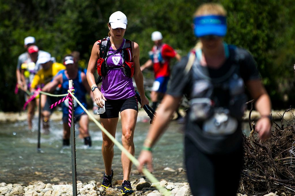 . Sarah Brittenham #99 and other runners make their way across Lake Creek during the 2014 Leadville Trail 100 ultramarathon on Saturday, August 16, 2014 in Twin Lakes, Colorado.  (Photo by Kent Nishimura/The Denver Post)