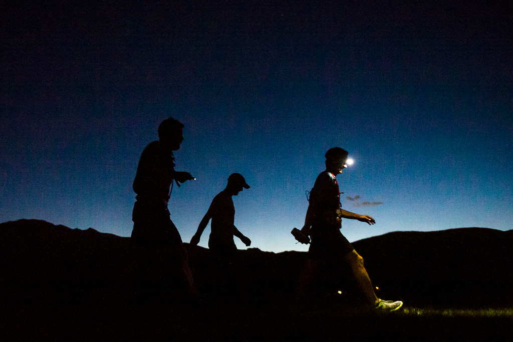 . LEADVILLE, CO - AUGUST 16:   Runners are cast in silhouette as light beings to fade during 2014 Leadville Trail 100 ultramarathon on Saturday, August 16, 2014 in Leadville, Colorado.  (Photo by Kent Nishimura/The Denver Post)