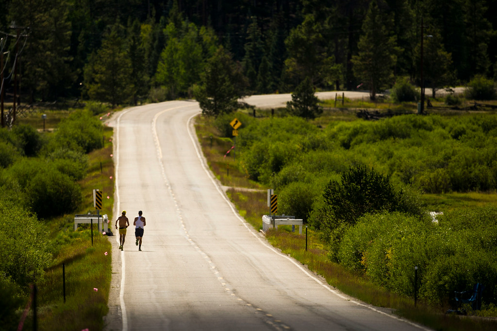 . Runner Rob Krar #376 is seen running along Highway 300 after leaving the Outward Bound Colorado aid station during the 2014 Leadville Trail 100 ultramarathon on Saturday, August 16, 2014 in Leadville, Colorado.  (Photo by Kent Nishimura/The Denver Post)