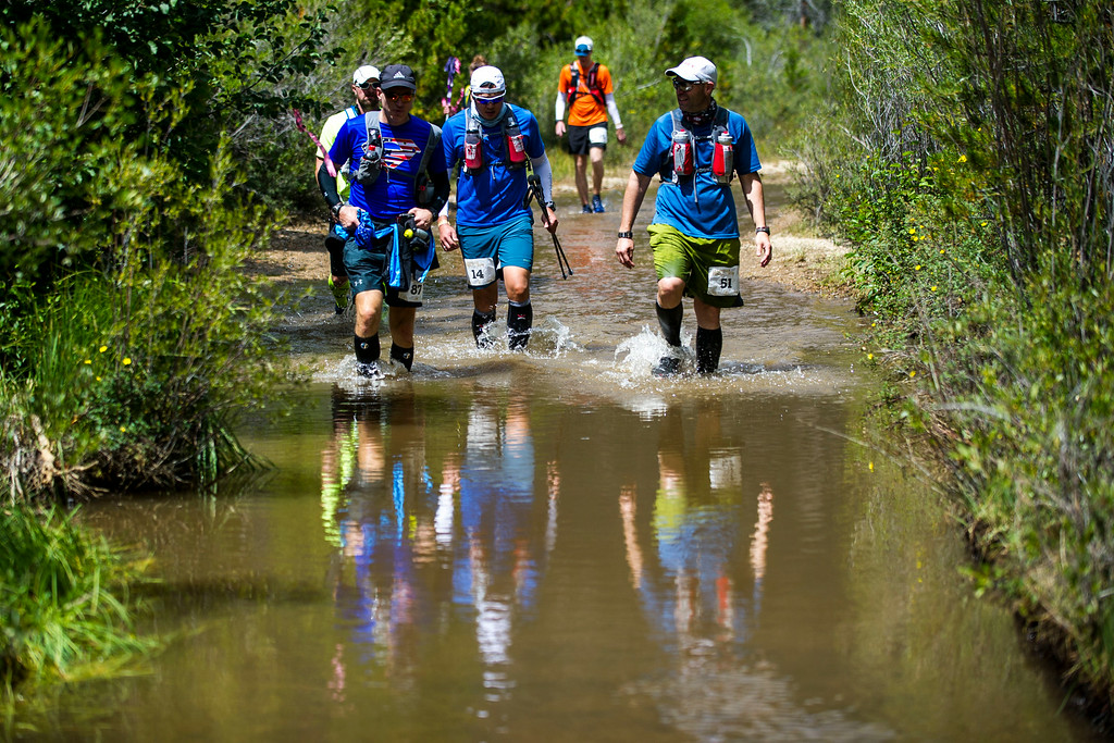 . Runners Ray Bovaird #87, Mark Agcaoili #14, and Joseph Bearss #51make their way along the route during the 2014 Leadville Trail 100 ultramarathon on Saturday, August 16, 2014 in Twin Lakes, Colorado.  (Photo by Kent Nishimura/The Denver Post)