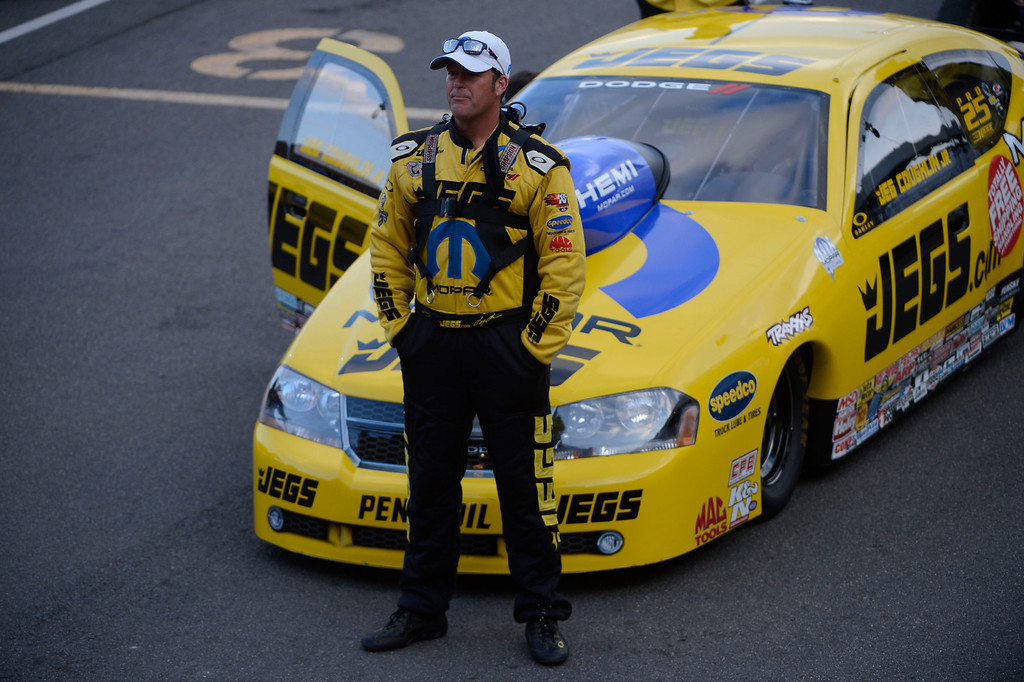. MORRISON, CO - JULY 19:  NHRA Pro Stock drag racer, Jeg Coughlin Jr. waits  in the staging lanes to race at the Mopar Mile-High Nationals Friday evening at Bandimere Speedway, July 19, 2013.  (Photo By Andy Cross/The Denver Post)