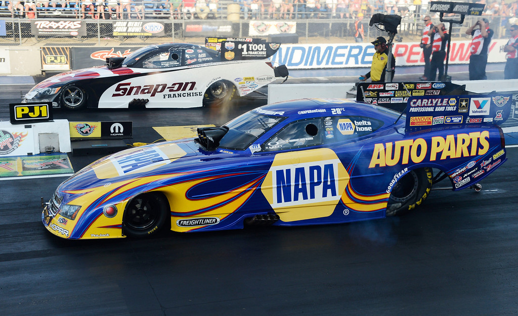 . MORRISON, CO - JULY 19:  NHRA Funny Car drivers, Cruz Pedregon, top and Ron Capps, bottom, race each other during the first round of qualifying during the Mopar Mile-High Nationals Friday evening at Bandimere Speedway, July 19, 2013.  (Photo By Andy Cross/The Denver Post)