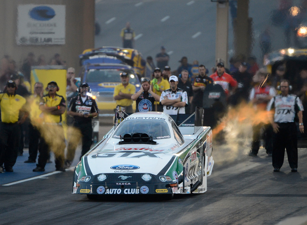 . MORRISON, CO - JULY 19:  NHRA Funny Car drag racer, John Force, takes off the line during qualifying at the Mopar Mile-High Nationals Friday evening at Bandimere Speedway, July 19, 2013.  (Photo By Andy Cross/The Denver Post)