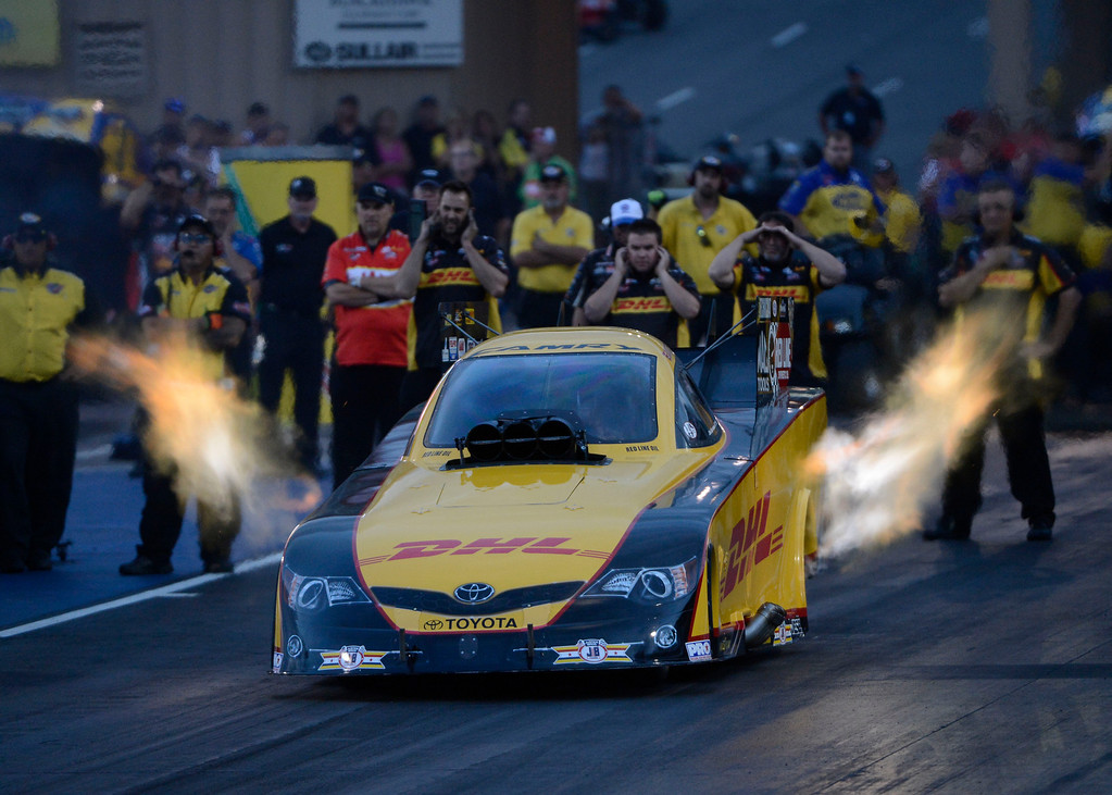 . MORRISON, CO - JULY 19:  NHRA Funny Car drag racer, Del Worsham, takes off the line during qualifying at the Mopar Mile-High Nationals Friday evening at Bandimere Speedway, July 19, 2013.  (Photo By Andy Cross/The Denver Post)