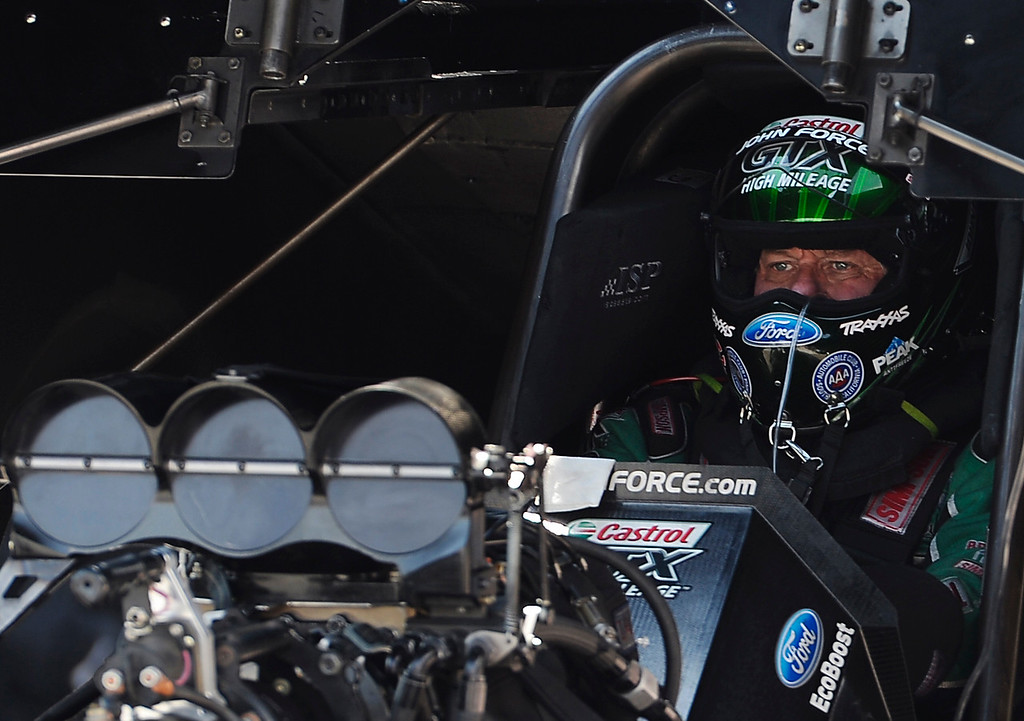 . John Force gathers his thoughts as he sits in his car during the second round of the Funny Car competition at the MOPAR Mile High Nationals July 20, 2014 at Bandimere Speedway. (Photo by John Leyba/The Denver Post)