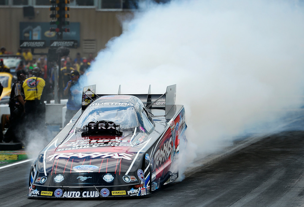 . Courtney Force during her burnout in the Funny Car competition in the second round of the MOPAR Mile High Nationals July 20, 2014 at Bandimere Speedway. (Photo by John Leyba/The Denver Post)