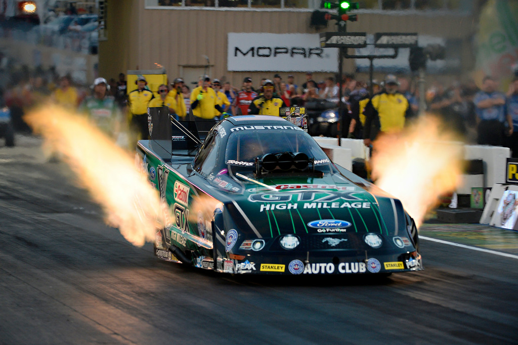 . MORRISON, CO. - JULY 18:  NHRA Funny Car driver, John Force lights it up on the line and sets a new track record with a E.T. of 4.049 and a speed of 318.39 mph Friday evening, July 18, 2014 during the 2014 Mopar Mile High NHRA Nationals at Bandimere Speedway. (Photo By Andy Cross / The Denver Post)