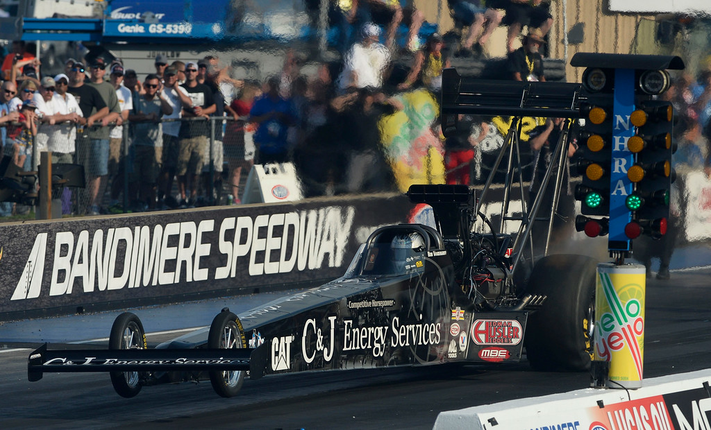 . MORRISON, CO. - JULY 18:  Top Fuel drag racer, Bob Vandergriff Jr. takes off the line Friday evening, July 18, 2014 during the 2014 Mopar Mile High NHRA Nationals at Bandimere Speedway. (Photo By Andy Cross / The Denver Post)