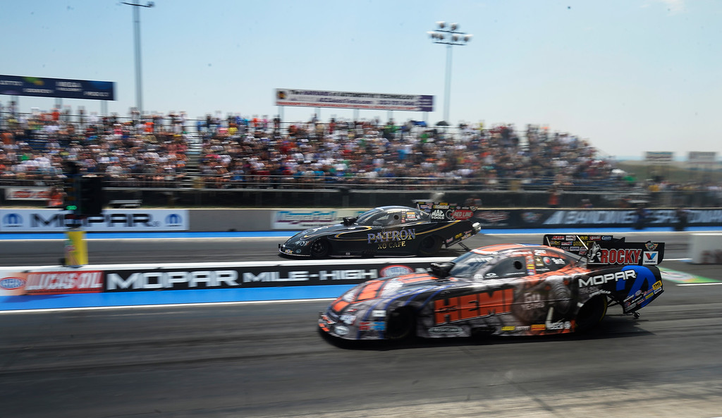 . Alexis DeJoria far lane take on Matt Hagan in the first round of the Funny Car competition at the MOPAR Mile High Nationals July 20, 2014 at Bandimere Speedway. (Photo by John Leyba/The Denver Post)
