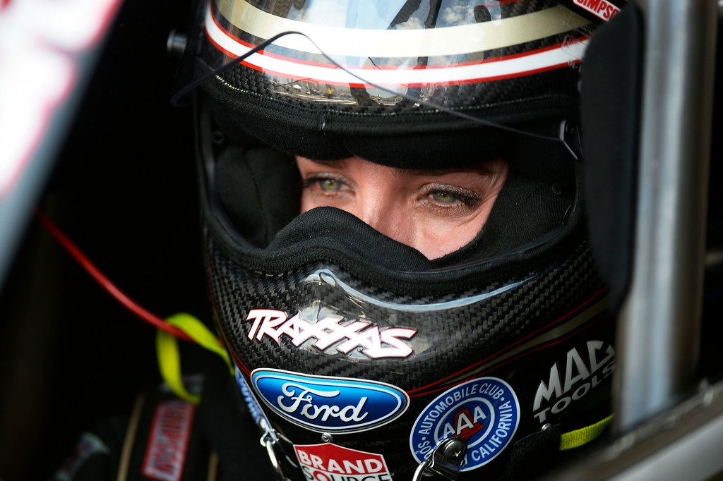 . Brittany Force sits in her Top Fuel car in Top Fuel competition at the MOPAR Mile High Nationals July 20, 2014 at Bandimere Speedway. (Photo by John Leyba/The Denver Post)