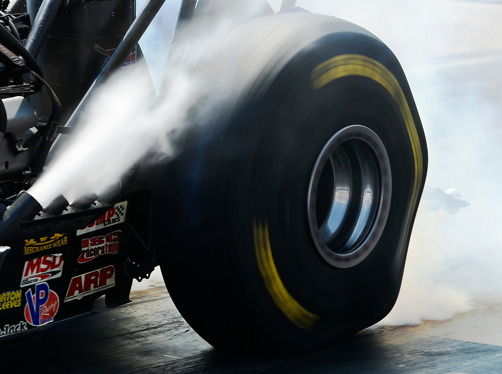 . Tires take a beating during the burnout of a Top Fuel car during the firs round at the MOPAR Mile High Nationals July 20, 2014 at Bandimere Speedway. (Photo by John Leyba/The Denver Post)