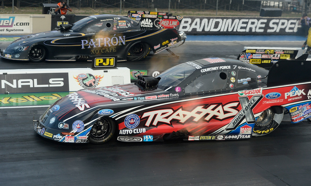 . MORRISON, CO. - JULY 18:  Funny Car drag racers, Courtney Force, right, races Alexis De Joria, top, in the first round of qualifying Friday evening, July 18, 2014 for the 2014 Mopar Mile High NHRA Nationals at Bandimere Speedway. (Photo By Andy Cross / The Denver Post)