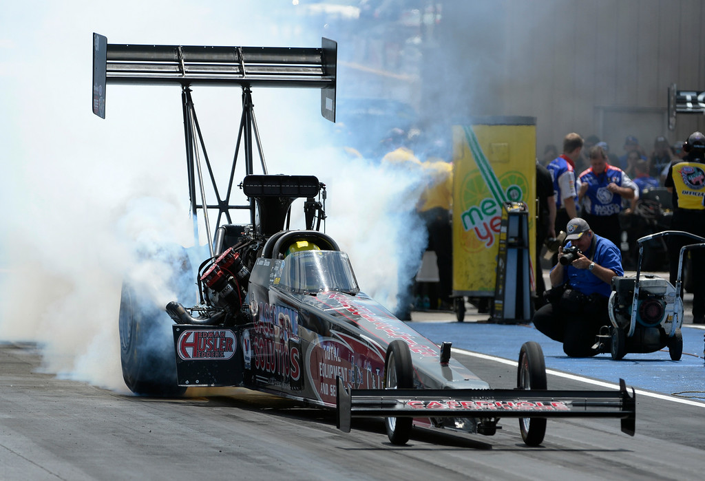 . NHRA Top Fuel driver, Larry Dixon, during his burn-out in the quarter-finals elimination round Sunday afternoon, July 20, 2014 at the 2014 Mopar Mile High NHRA Nationals at Bandimere Speedway. (Photo By Andy Cross / The Denver Post)