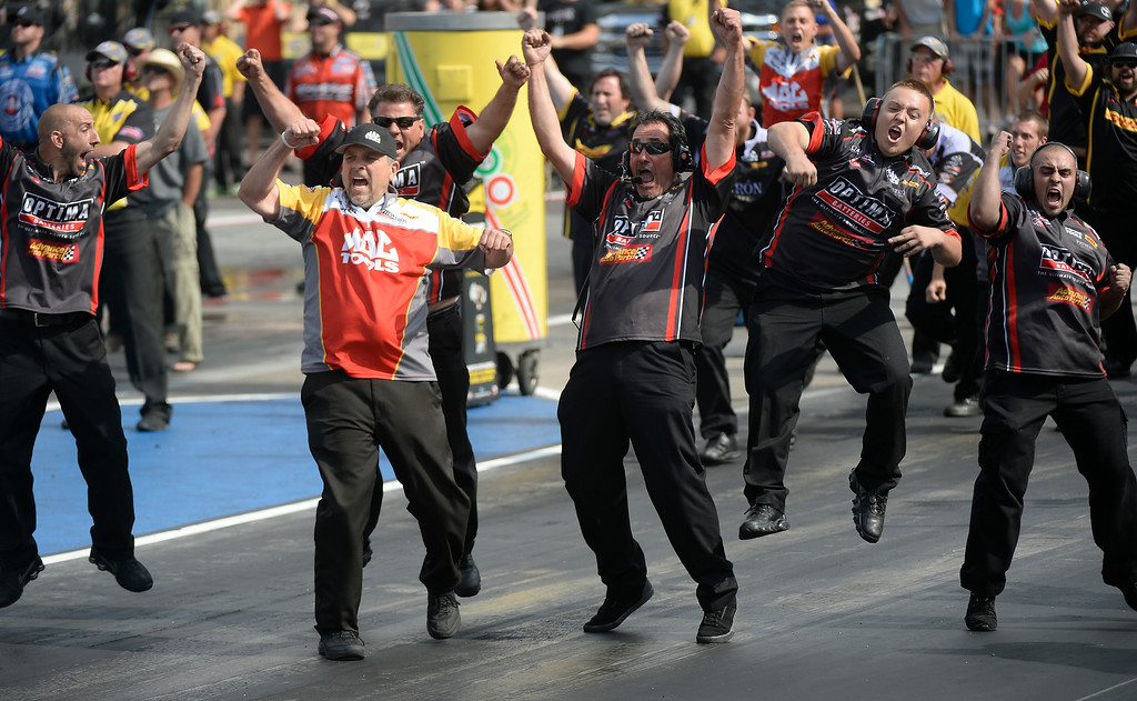 . JR Todd defeats Brittany Force to take the Top Fuel title as the crew celebrates at the start line during the MOPAR Mile High Nationals July 20, 2014 at Bandimere Speedway. (Photo by John Leyba/The Denver Post)