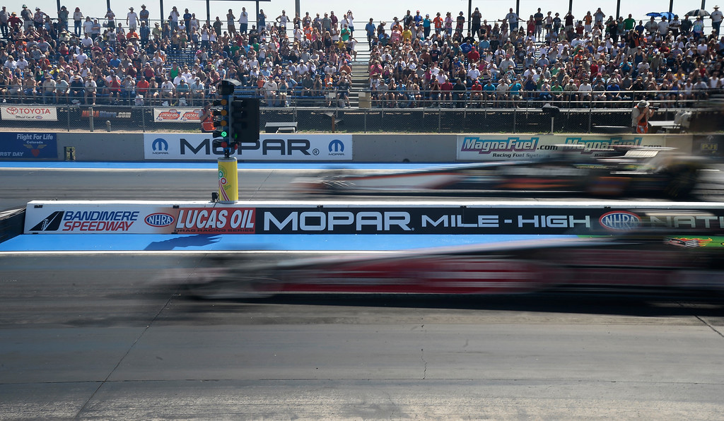 . Top Fuel car take off at the start reaching over 300 MPH are just a blur during the first round of Top Fuel competition at the MOPAR Mile High Nationals July 20, 2014 at Bandimere Speedway. (Photo by John Leyba/The Denver Post)