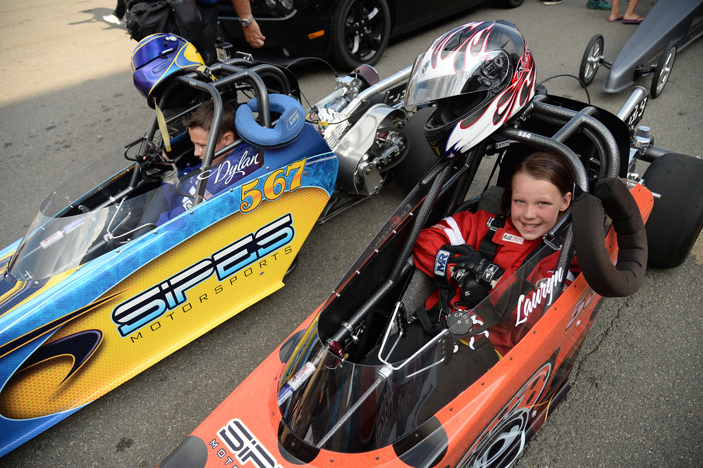 . MORRISON, CO - JULY 19: Junior racers Lauryn Pipes, 9, right, and her brother Dylan, 13, are preparing for their race during Mopar Mile-High NHRA Nationals at Bandimere Speedway. Morrison, Colorado. July 19. 2014. (Photo by Hyoung Chang/The Denver Post)