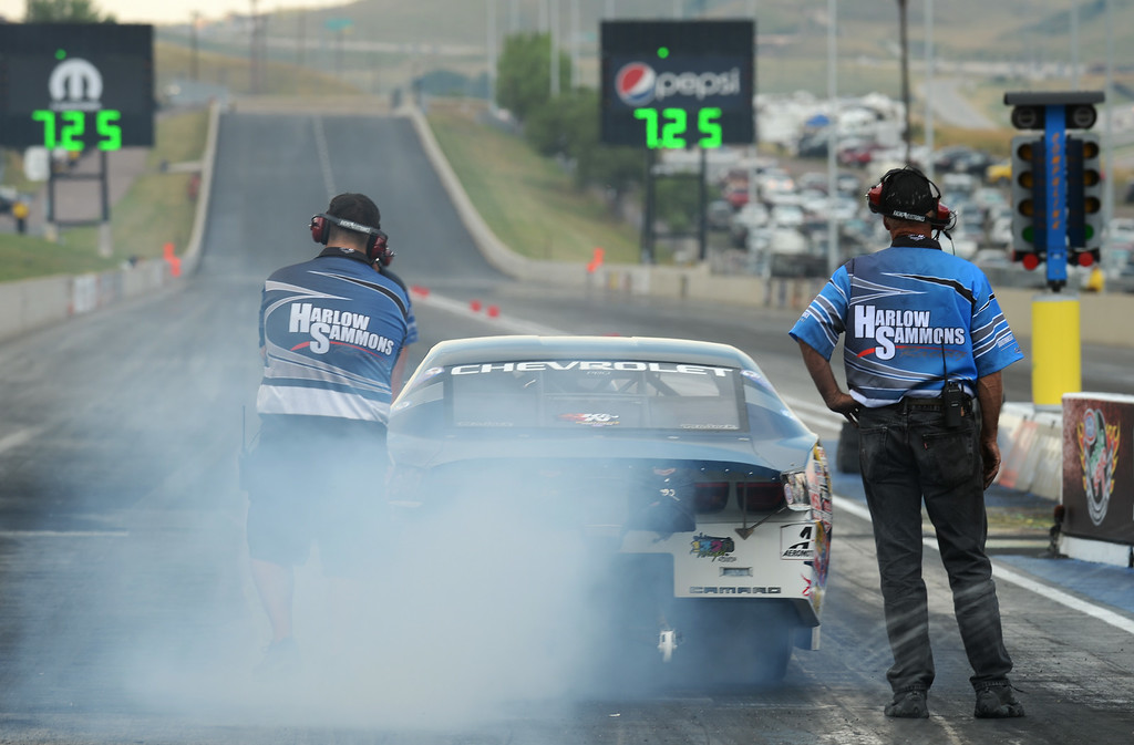 . MORRISON, CO - JULY 19: Pro Stock racer Chris McGaha is warming up the tire for the race during Mopar Mile-High NHRA Nationals at Bandimere Speedway. Morrison, Colorado. July 19. 2014. (Photo by Hyoung Chang/The Denver Post)