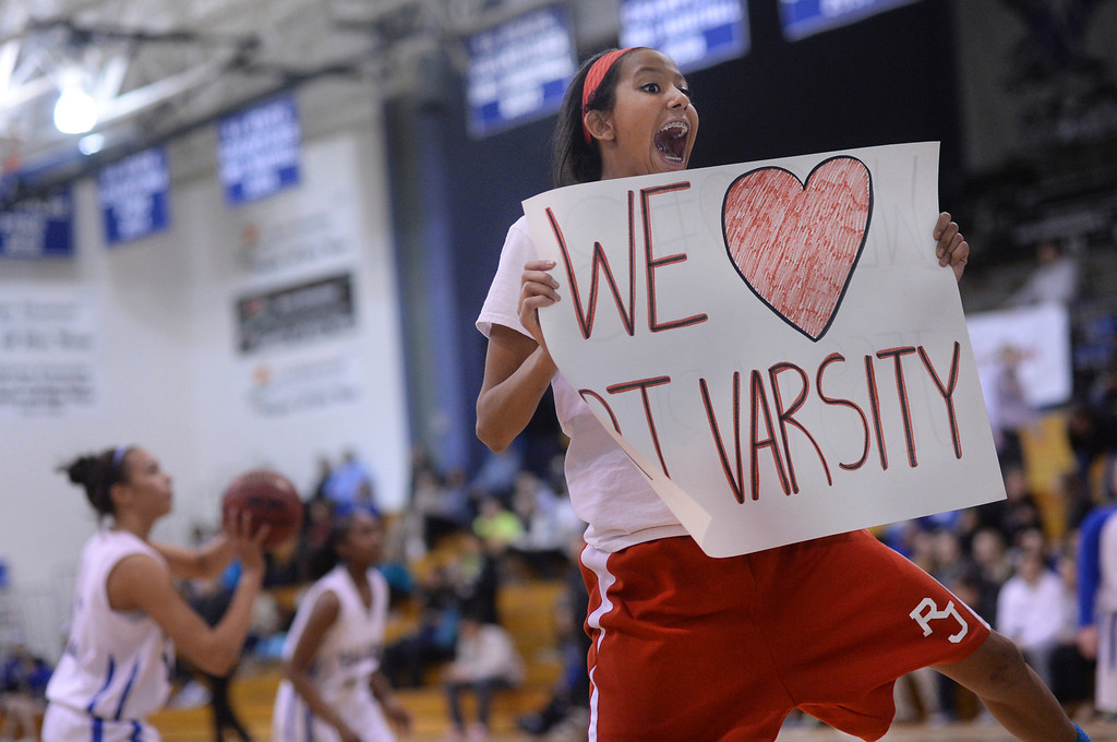 . Regis sophomore Dessy Scaife showed her spirt. The Highlands Ranch High School girl\'s basketball team hosted Regis Jesuit Wednesday night, February 5, 2014. Photo By Karl Gehring/The Denver Post