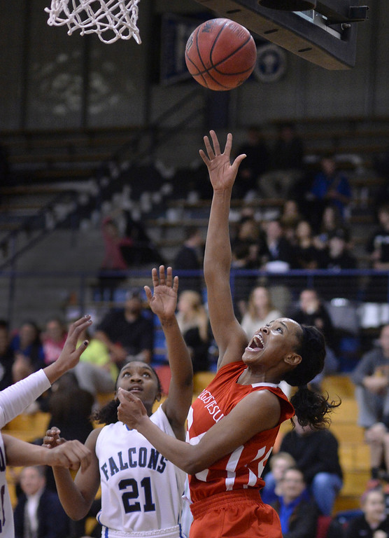 . Regis senior guard Neffie Lockley (24) put up a shot under the bucket in the second half. The Regis Jesuit High School girl\'s basketball team defeated Highlands Ranch 69-38 Wednesday night, February 5, 2014. Photo By Karl Gehring/The Denver Post