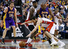 Toronto Raptors' Jose Calderon (bottom R) drives as teammate Amir Johnson (C) sets a pick on Los Angeles Lakers' Kobe Bryant (24) during the second half of their NBA basketball game in Toronto, January 20, 2013.     REUTERS/Mark Blinch