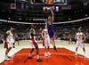 Los Angeles Lakers' Pau Gasol (C) goes up for a slam dunk past the Toronto Raptors during the first half of their NBA basketball game in Toronto, January 20, 2013.  REUTERS/Mark Blinch