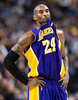 Los Angeles Lakers guard Kobe Bryant bites his jersey while playing against the Toronto Raptors during the first half of an NBA basketball game, Sunday, Jan. 20, 2013, in Toronto. The Raptors won 108-103. (AP Photo/The Canadian Press, Nathan Denette)