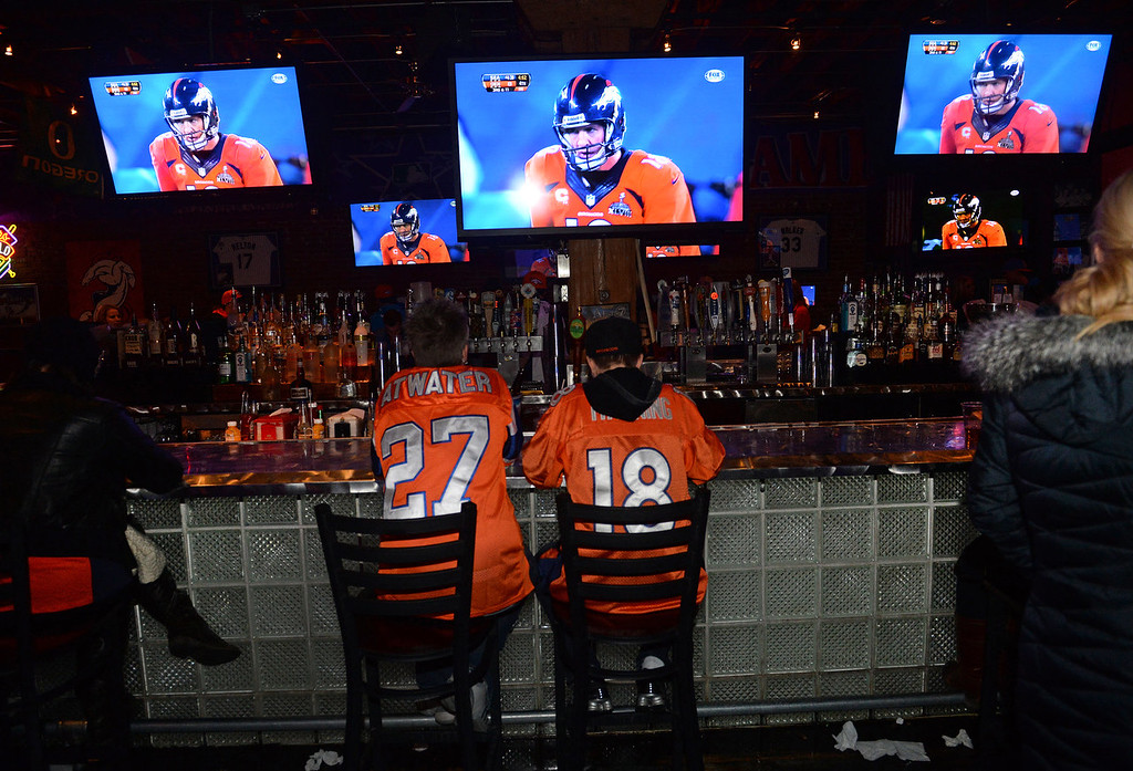 . Two broncos fans remain at the bar as many had already left as the Broncos continued to lose during the Super Bowl at Jackson\'s bar in Denver, Co on February 2, 2014. The Broncos took on the Seattle Seahawks in Super Bowl XLVIII at the Met Life stadium in New Jersey. The Broncos lost to the Seattle Seahawks 43-8.  (Photo By Helen H. Richardson/ The Denver Post)