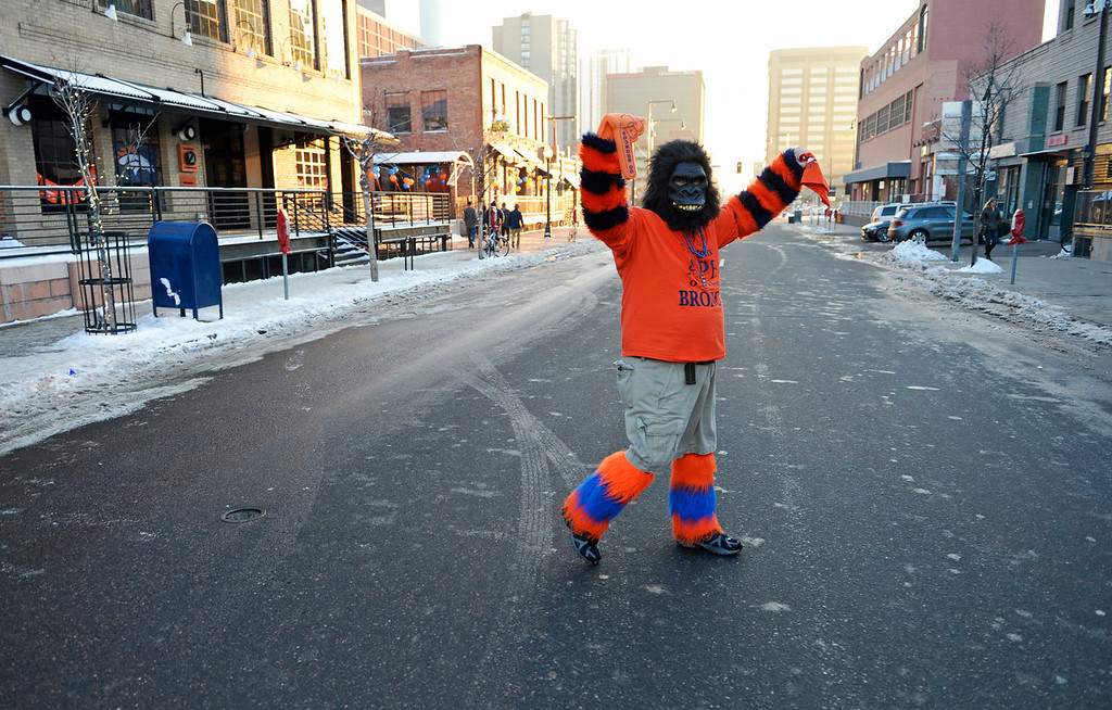 . Denver Broncos fan Sam Dobbins, dress up as an ape, gives a disappointed foam finger down as he crosses Market Street in downtown Denver, February, 02 2014. Dobbins is upset with the start of the game as the Denver Broncos take on the Seattle Seahawks during NFL Super Bowl XLVIII football game. (Photo by RJ Sangosti/The Denver Post)