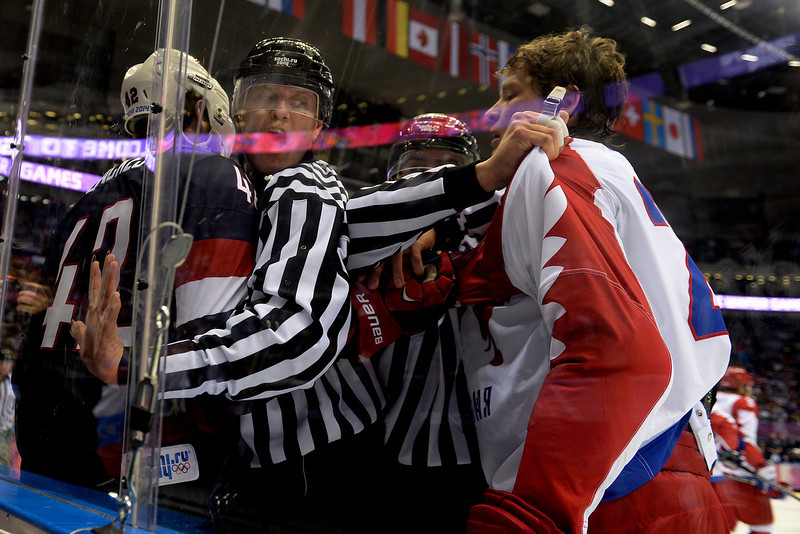. Things get chippy between David Backes (42) of the U.S.A. and Alexander Syomin (28) of the Russia early during the first period of men\'s hockey action at Bolshoy arena. Sochi 2014 Winter Olympics on Saturday, February 15, 2014. (Photo by AAron Ontiveroz/The Denver Post)