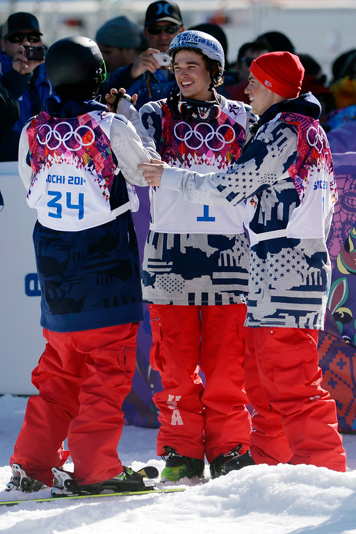 . U.S.A. skier Nick Goepper (center) high fives Joss Christensen as teammate Gus Kenworthy looks on after the trio swept the podium during the men\'s ski slopestyle final at the Rosa Khutor Extreme Park. Sochi 2014 Winter Olympics on Thursday, February 13, 2014. (Photo by AAron Ontiveroz/The Denver Post)