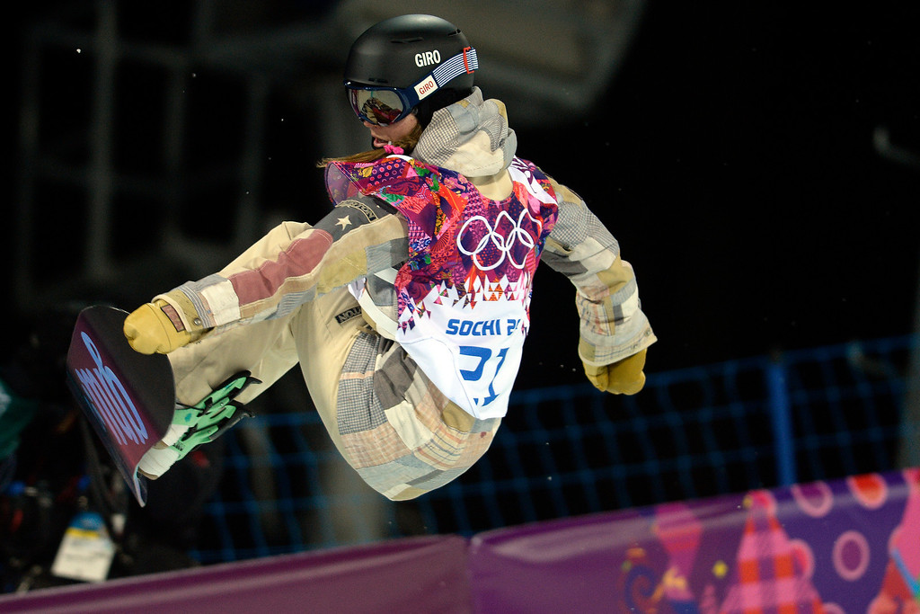 . Gold medalist American Kaitlyn Farrington makes a nose grab during a women\'s snowboard halfpipe final at the Rosa Khutor Extreme Park during the Sochi 2014 Winter Olympics on Wednesday, February 12, 2014. (Photo by AAron Ontiveroz/The Denver Post)