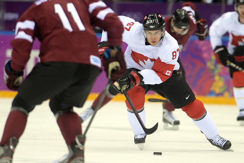 . Sidney Crosby (87) of the Canada brings the puck up the ice against Latvia during the first period of men\'s hockey action. Sochi 2014 Winter Olympics on Wednesday, February 19, 2014 at Bolshoy Ice Arena. (Photo by AAron Ontiveroz/ The Denver Post)
